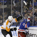 Philadelphia Flyers' Scott Hartnell (19) checks New York Rangers' Ryan McDonagh (27) during the first period in Game 1 of an NHL hockey first-round playoff series on Thursday, April 17, 2014, in New York The Associated Press