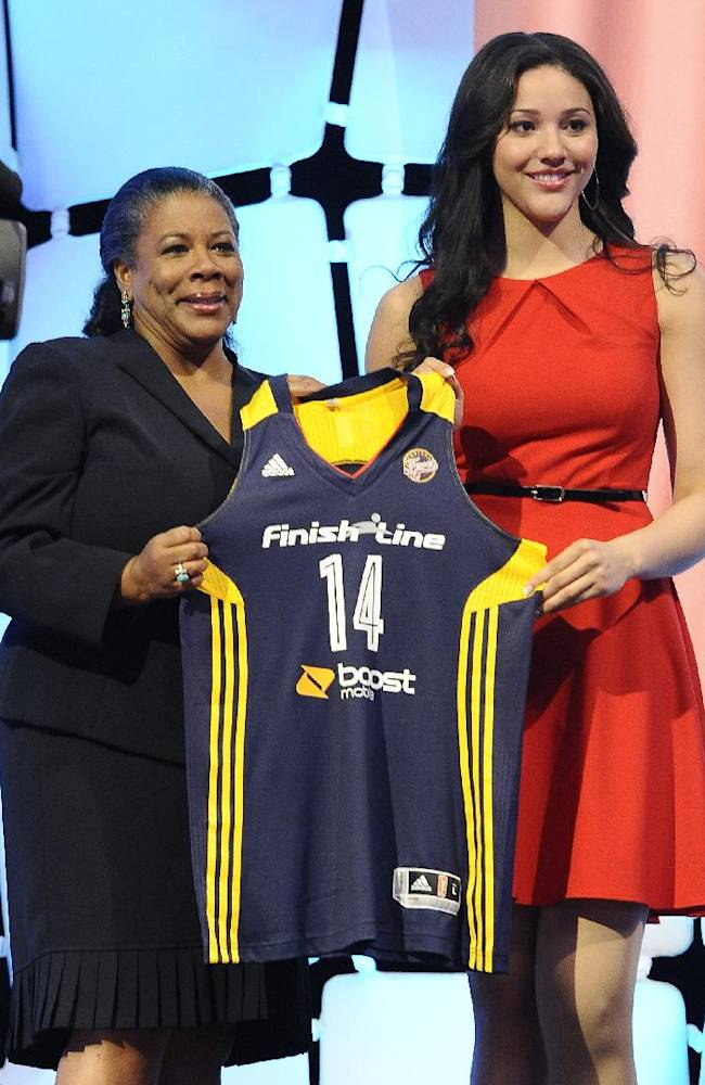Notre Dame's Natalie Achonwa holds up an Indiana Fever jersey with WNBA president Laurel J. Richie after Indiana selected Achonwa as the No. 9 pick in the WNBA basketball draft in, Monday, April 14, 2014, in Uncasville, Conn