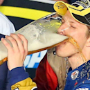 Brad Keselowski made sure he paid tribute to sponsor Miller Lite while celebrating his first championship. (Getty Images)