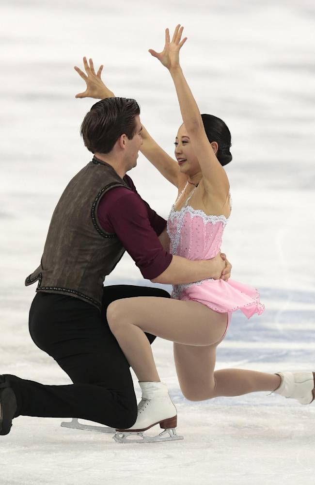 Felicia Zhang and Nathan Bartholomay of the United States compete in the pairs short program figure skating competition at the Iceberg Skating Palace during the 2014 Winter Olympics, Tuesday, Feb. 11, 2014, in Sochi, Russia