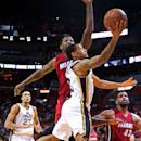 MIAMI, FL - DECEMBER 17: Trey Burke #3 of the Utah Jazz drives past Udonis Haslem #40 of the Miami Heat during a game  at American Airlines Arena on December 17, 2014 in Miami, Florida. NOTE TO USER: User expressly acknowledges and agrees that, by downloading and/or using this photograph, user is consenting to the terms and conditions of the Getty Images License Agreement. Mandatory copyright notice:  (Photo by Mike Ehrmann/Getty Images)