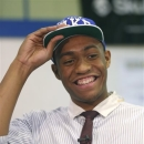 FILE - In this Dec. 20, 2012, file photo, Simeon Career Academy's Jabari Parker smiles as he puts on a Duke University cap after announcing he will be attending Duke during a news conference at his high school in Chicago. Parker has signed his letter of intent to play at Duke, the school announced Thursday, May 2, 2013. Because that decision came in December after the conclusion of the fall signing period, Parker had to wait until the spring signing period began April 17 to make it official. (AP Photo/Charles Rex Arbogast, File)