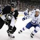 Pittsburgh Penguins' Evgeni Malkin (71) works the puck in the corner with Tampa Bay Lightning's Ryan Callahan (24) defending during the second period of an NHL hockey game in Pittsburgh Monday, Dec. 15, 2014 The Associated Press