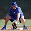 Los Angeles Dodgers infielder Justin Turner fields a ball during spring training baseball practice Tuesday, Feb. 11, 2014, in Glendale, Ariz The Associated Press