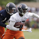 Chicago Bears cornerback Sherrick McManis (27), right, intercepts the ball against wide receiver Eric Weems (14) during team's NFL football training camp at Olivet Nazarene University on Friday, July 25, 2014., in Bourbonnais, Ill The Associated Press