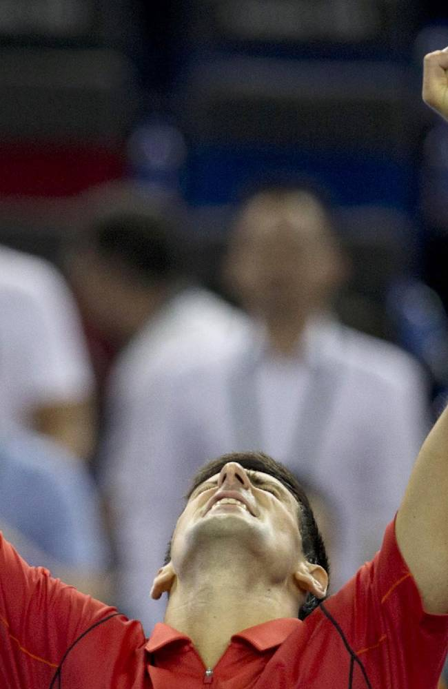 Serbia's Novak Djokovic celebrates his win over France's Jo-Wilfried Tsonga during the singles semifinal match of the Shanghai Masters tennis tournament at the Qizhong Forest Sports City Tennis Center in Shanghai, China on Saturday, Oct. 12, 2013. Djokovic won  6-2, 7-5