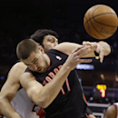 Toronto Raptors' Jonas Valanciunas (17) and Milwaukee Bucks' ZaZa Pachulia wrestle for a rebound during the first half of an NBA basketball game Saturday, April 5, 2014, in Milwaukee The Associated Press