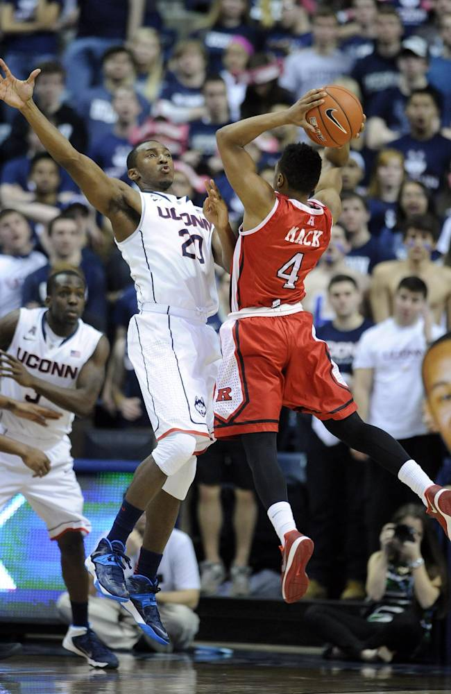 Connecticut's Lasan Kromah (20) guards Rutgers' Myles Mack (4) during the second half of Connecticut's 69-63 victory in an NCAA college basketball game in Storrs, Conn., Wednesday, March 5, 2014
