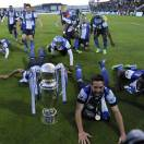 FC Porto's players celebrate with the trophy after their 2-0 victory over Pacos Ferreira in the last match of the Portuguese League soccer season at Mata Real stadium in Pacos de Ferreira, Portugal, Sunday, May 19, 2013. Porto clinched their 27th Portuguese League title. (AP Photo/Paulo Duarte)