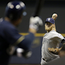 San Diego Padres starting pitcher Andrew Cashner throws to Milwaukee Brewers' Carlos Gomez during the first inning of a baseball game Monday, April 21, 2014, in Milwaukee The Associated Press