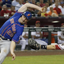 New York Mets' Daniel Murphy (28) eludes the attempted tag of Arizona Diamondbacks' Miguel Montero, right, to score a run during the third inning of a baseball game on Monday, April 14, 2014, in Phoenix The Associated Press