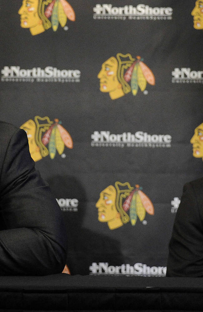 Chicago Blackhawks players Jonathan Toews, left,  and Patrick Kane smile during a news conference at the United Center in Chicago, Wednesday, July 16, 2014. The Blackhawks recently agreed to eight-year contract extensions with for their star players