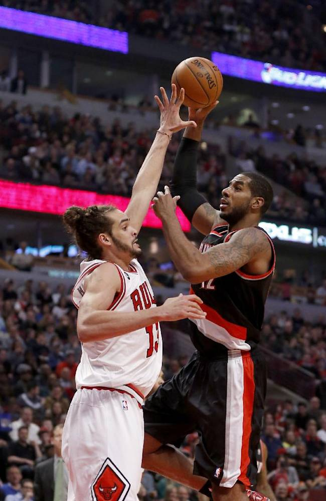 Portland Trail Blazers forward LaMarcus Aldridge, right, shoots over Chicago Bulls center Joakim Noah (13) during the first half of an NBA basketball game Friday, March 28, 2014, in Chicago