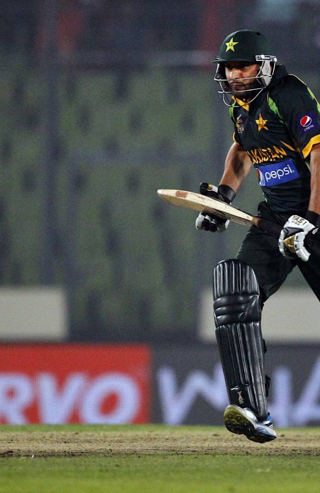 Pakistan's Shahid Afridi runs after playing a shot during the Asia Cup one-day international cricket tournament against India in Dhaka, Bangladesh, Sunday, March 2, 2014. Pakistan won by 1 wicket