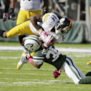 In this Oct. 13, 2013 file photo, New York Jets' Isaiah Trufant (35) tackles Pittsburgh Steelers' Antonio Brown (84) during the second half of an NFL football game, in East Rutherford, N.J. The Browns have agreed to terms with free agent cornerback Isaiah