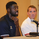 Liverpool Football Club defender Kolo Toure, left, and manager Brendan Rodgers answer questions during a news conference, Tuesday, July 29, 2014, in New York. Liverpool will take on Manchester City Football Club at Yankee Stadium on Wednesday in the Guinn