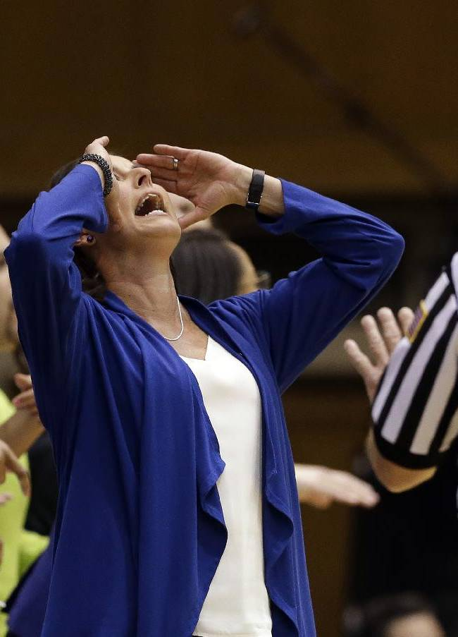 Duke coach Joanne P. McCallie, center, reacts to an official's call during the second half of an NCAA college basketball game against Wake Forest in Durham, N.C., Thursday, Feb. 27, 2014. Duke won 71-56