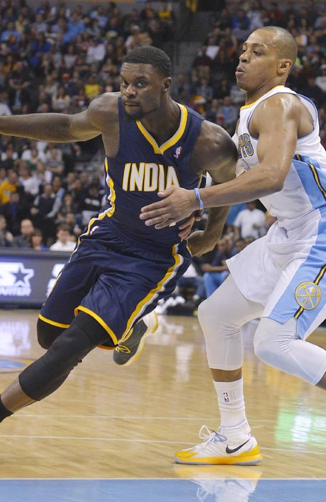 Indiana Pacers shooting guard Lance Stephenson (1) drives around Denver Nuggets shooting guard Randy Foye (4) during the third quarter of an NBA basketball game Saturday, Jan. 25, 2014, in Denver