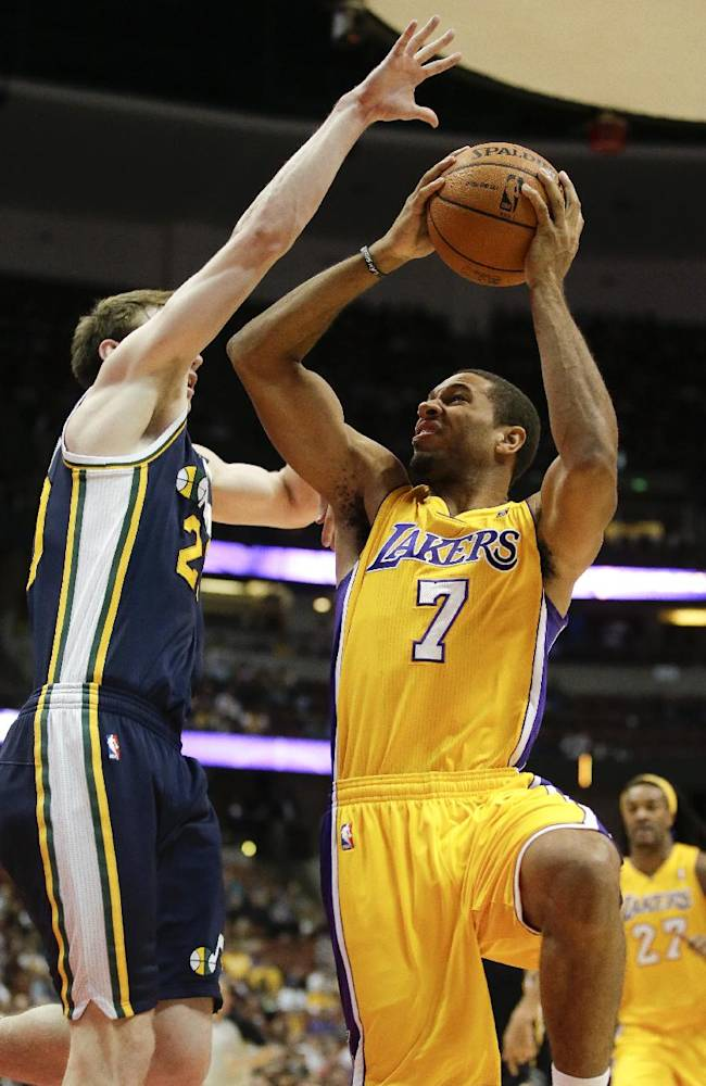 Los Angeles Lakers guard Xavier Henry, right, shoots over Utah Jazz forward Gordon Hayward during the first half of a preseason NBA basketball game in Anaheim, Calif., Friday, Oct. 25, 2013