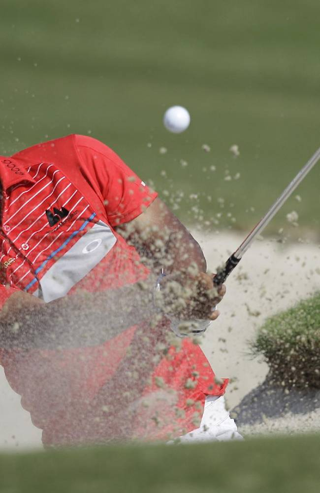 Thongchai Jaidee from Thailand plays a bunker shot on the 2nd hole during the 2nd round of DP World Golf Championship in Dubai, United Arab Emirates, Friday, Nov. 15, 2013