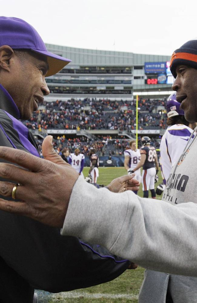 In this Nov. 25, 2012, file photo, Chicago Bears coach Lovie Smith, right, is greeted by Minnesota Vikings coach Leslie Frazier after the Bears' 28-10 win in an NFL football game in Chicago. A person familiar with the negotiations says former Bears coach Smith has reached an agreement to coach the Tampa Bay Buccaneers. Speaking to The Associated Press on Wednesday night, Jan. 1, 2014, on the condition of anonymity because an official announcement hasn't been made, the person also says former Vikings coach Frazier will be the Buccaneers' defensive coordinator