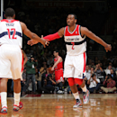 WASHINGTON, DC - APRIL 2: John Wall #2 and A.J. Price of the Washington Wizards celebrate a made shot against the Chicago Bulls during the game at the Verizon Center on April 2, 2013 in Washington, DC. (Photo by Ned Dishman/NBAE via Getty Images)