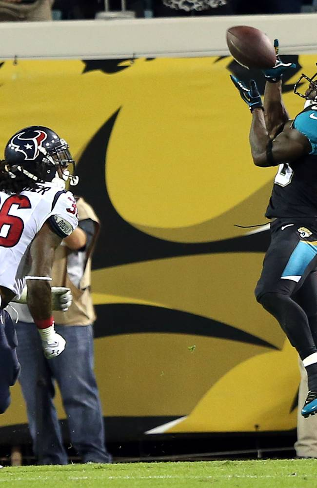 12/5/13 - Jags RB Jordan Todman (30) gathers in a pass from Ace Sanders for a TD at 6:12 in the 3rd quarter for the Jaguars to take a 24-10 lead. The Jacksonville Jaguars played a Thursday night game on Dec. 5, 2013 against the Houston Texans on EverBank Field in Jacksonville, FL