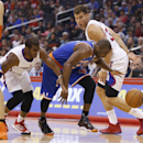 New York Knicks' Raymond Felton, center, takes the ball between Los Angeles Clippers' Chris Paul, left, and Blake Griffin, right, during the first half of an NBA basketball game in Los Angeles, Wednesday, Nov. 27, 2013 The Associated Press
