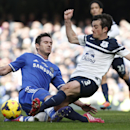 Chelsea's Frank Lampard, left, fights for the ball with Everton's Leighton Baines, right, during an English Premier League soccer match at the Stamford Bridge ground in London, Saturday, Feb. 22, 2014. Chelsea won the match 1-0