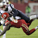 Kansas City Chiefs running back Jamaal Charles is stopped by New England Patriots linebacker Jamie Collins (91) after running for a 5-yard gain during the third quarter of an NFL football game Monday, Sept. 29, 2014, in Kansas City, Mo The Associated Pres