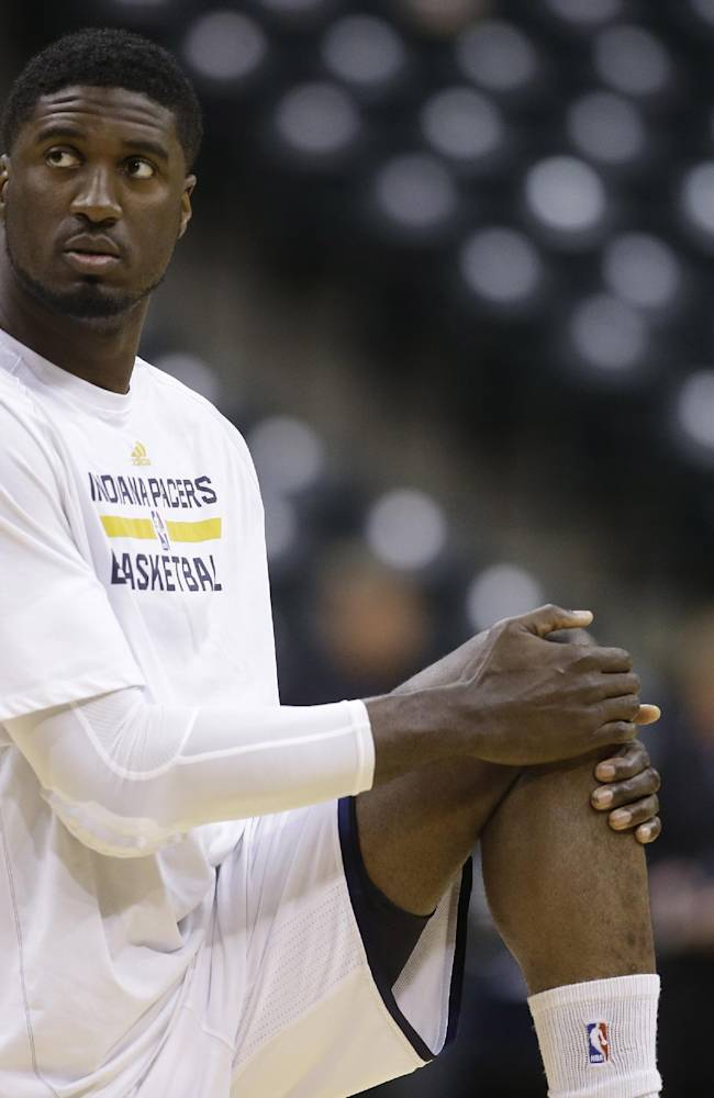 Indiana Pacers' Roy Hibbert (55) stretches during warmups before game 5 of the Eastern Conference semifinal NBA basketball playoff series against the Washington Wizards Tuesday, May 13, 2014, in Indianapolis