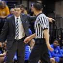 Kentucky coach Matthew Mitchell questions referee Frank Steratore concerning a flagrant-foul call during the second half of an NCAA college basketball game against LSU in Baton Rouge, La., Sunday, Feb. 24, 2013. LSU upset No. 8 Kentucky 77-72. (AP Photo/Bill Feig)