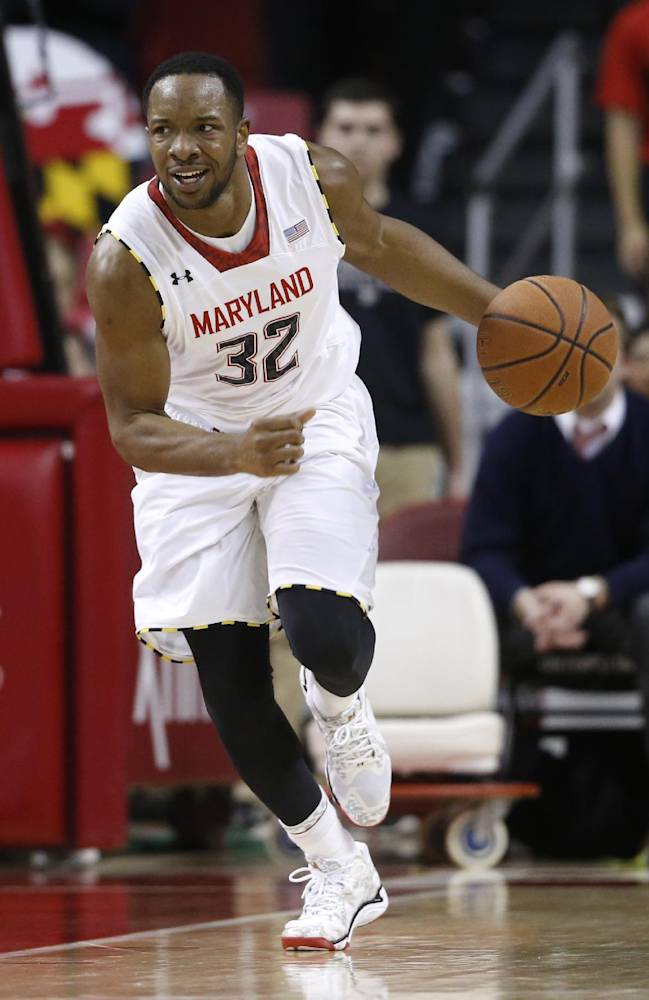 In this March 4, 2014 file photo, Maryland's Dez Wells against Virginia Tech in the second half of an NCAA college basketball game in College Park, Md. Wells, a former Xavier University player, has settled his lawsuit against the school over their handling of what he says was a false rape allegation. Federal Judge S. Arthur Spiegel dismissed Dez Wells' lawsuit against Xavier on Thursday,  April 24, 2014, saying the two had resolved their conflict