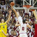 Indiana's Cody Zeller (40) takes a rebound back to the basket for a dunk against Michigan during the first half of an NCAA college basketball game Saturday, Feb. 2, 2013, in Bloomington, Ind. (AP Photo/Doug McSchooler)