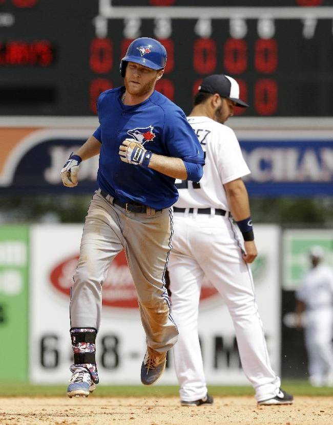 Toronto Blue Jays' Dan Johnson rounds second base after his two-run home run during the seventh inning of a spring exhibition baseball game in Lakeland, Fla., Tuesday, March 11, 2014