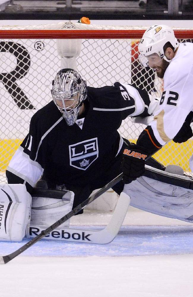 Anaheim Ducks left wing Patrick Maroon, right, tries to get a shot in on Los Angeles Kings goalie Martin Jones during the third period in Game 4 of an NHL hockey second-round Stanley Cup playoff series, Saturday, May 10, 2014, in Los Angeles. The Duck won 2-0