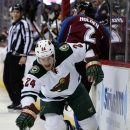 Minnesota Wild left wing Matt Cooke reaches to control the puck against the Colorado Avalanche in the first period of Game 2 of an NHL hockey first-round playoff series on Saturday, April 19, 2014, in Denver The Associated Press