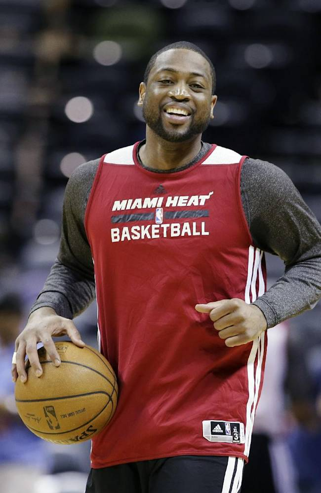 From left, Miami Heat forward Michael Beasley, guard Dwyane Wade and forward Udonis Haslem warm up during basketball practice on Wednesday, June 4, 2014 in San Antonio. They play Game 1 of the NBA Finals against the San Antonio Spurs on Thursday