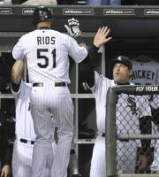 Chicago White Sox's Alex Rios (51), celebrates with manager Robin Ventura right, after hitting a solo home run in the fourth inning during a baseball game against the Tampa Bay Rays in Chicago, Friday, Sept. 28, 2012. (AP Photo/Paul Beaty)