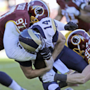 St. Louis Rams quarterback Shaun Hill (14) is sacked by Washington Redskins defensive end Jason Hatcher (97) and outside linebacker Trent Murphy (93) during the first half of an NFL football game in Landover, Md., Sunday, Dec. 7, 2014 The Associated Press