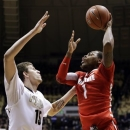 Ohio State forward Deshaun Thomas, right, shoots over Purdue forward Donnie Hale in the first half of an NCAA college basketball game in West Lafayette, Ind., Tuesday, Jan. 8, 2013. (AP Photo/Michael Conroy)