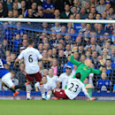Everton's Seamus Coleman, left, scores his side's third goal of the game during their English Premier League soccer match against Aston Villa at Goodison Park, Liverpool, England, Saturday, Oct. 18, 2014