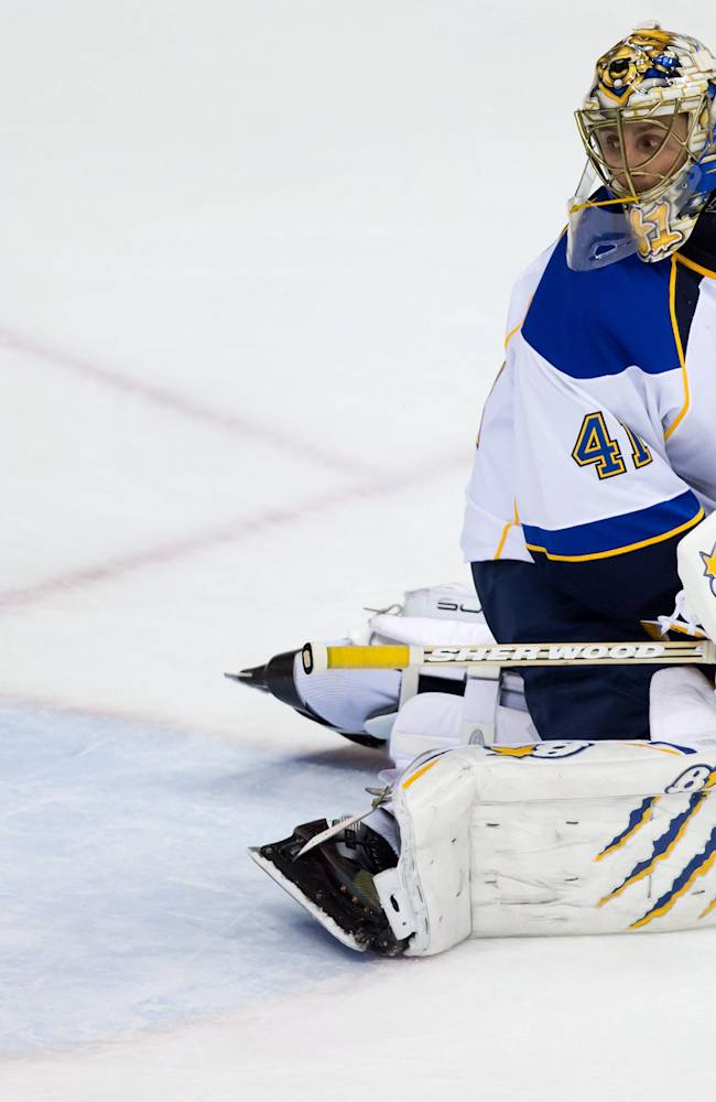 St. Louis Blues' goalie Jaroslav Halak, of Slovakia, allows the only goal of the game to Vancouver Canucks' Jannik Hansen, of Denmark, during third period NHL hockey action in Vancouver, British Columbia, on Wednesday, Feb. 26, 2014