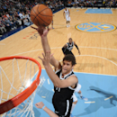 Lopez scores 19 points, Nets beat Nuggets 110-82 The Associated Press