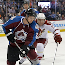 Colorado Avalanche defenseman Nick Holden (2) and Phoenix Coyotes right wing Radim Vrbata (17) chase the puck into the corner during the second period of an NHL hockey game on Friday, Feb. 28, 2014, in Denver The Associated Press