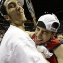 Mississippi guard Marshall Henderson (22) embraces Mississippi forward Anthony Perez (13)after the second half of an NCAA college basketball game in the final round of the Southeastern Conference tournament, Sunday, March 17, 2013, in Nashville, Tenn. Mississippi won 66-63.(AP Photo/John Bazemore)