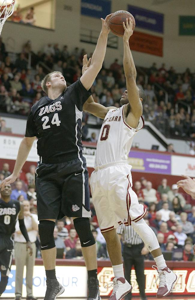 Gonzaga center Przemek Karnowski (24) blocks a shot by Santa Clara forward Jerry Brown (0) in the second half of an NCAA college basketball game Wednesday, Jan. 29, 2014, in Santa Clara, Calif. Gonzaga won 54-52