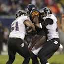 Chicago Bears wide receiver Alshon Jeffery gets sandwiched by Baltimore Ravens linebacker Daryl Smith, left, and cornerback Jimmy Smith during the second half of an NFL football game, Sunday, Nov. 17, 2013, in Chicago The Associated Press