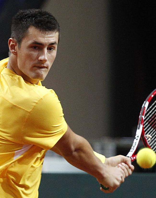 Australia's Bernard Tomic returns a shot to Poland's Lukasz Kubot  during their Davis Cup play-off round tennis match in Warsaw, Poland, Sunday, Sept. 15, 2013