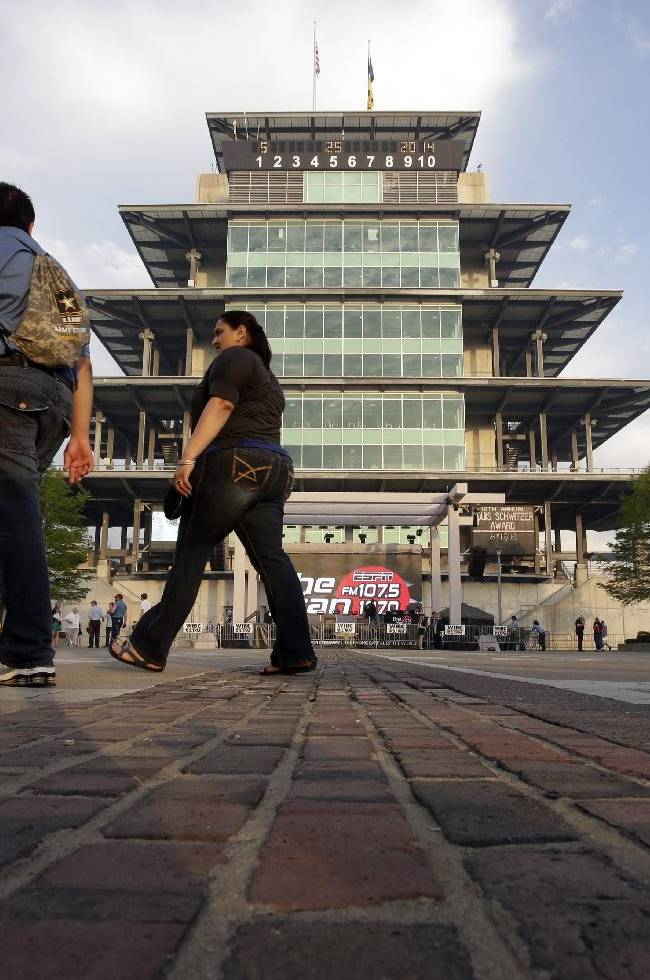 Fans arriving for the Indianapolis 500 IndyCar auto race walk across the Yard of Bricks extension of the start/finish line before the start of the race at the Indianapolis Motor Speedway in Indianapolis, Sunday, May 25, 2014. The 98th running of the Indianapolis 500 was Sunday